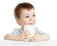 Child drinking milk from glass. Child boy drinking milk or yogurt from glass Royalty Free Stock Photo