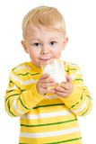 Child drinking milk from glass. Child boy drinking milk or yogurt from glass Royalty Free Stock Images