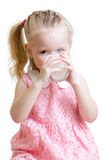 Child drinking milk from glass. Child girl drinking milk or yogurt from glass Stock Image