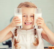 Child drinking milk at home Royalty Free Stock Photography
