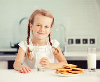 Child drinking milk at home Royalty Free Stock Image