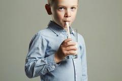 Child drinking milk.Little smiling Boy enjoy milk cocktail. Healthy life Stock Photos