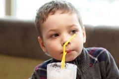 Child drinking milkshake Royalty Free Stock Image