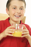 A child drinking orange juice Stock Photography