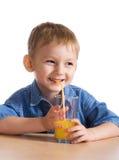Child drinking orange juice Stock Photo