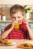 Child drinking orange juice Stock Photo