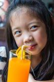 Child Drinking Orange Juice Stock Image