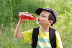 Child drinking outdoors Stock Images