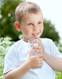Child drinking pure water Royalty Free Stock Image