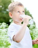 Child drinking pure water Stock Image