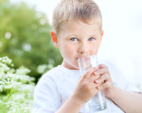 Child drinking pure water Royalty Free Stock Images