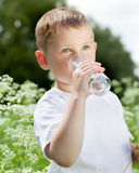Child drinking pure water Royalty Free Stock Photos