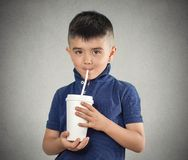 Child drinking with a straw Royalty Free Stock Images