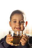 Child drinking tea Royalty Free Stock Photography