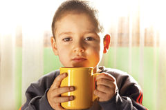 Child drinking tea Stock Photos