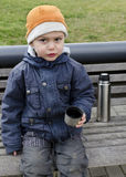 Child drinking tea from flask. Royalty Free Stock Photo