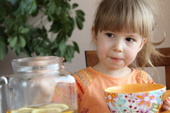 Child drinking a tea Stock Images