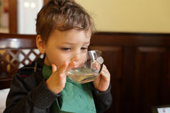 Child drinking tea Stock Image