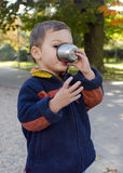 Child drinking tea in park Stock Images