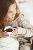 Child drinking tea Stock Images