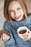Child drinking tea Royalty Free Stock Photography