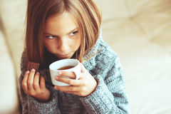 Child drinking tea Royalty Free Stock Image