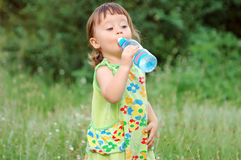 The child drinking water Stock Images