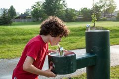 Child drinking from a water fountain Royalty Free Stock Image