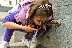 Child drinking water from a fountain Royalty Free Stock Photos