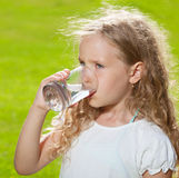 Child drinking water Royalty Free Stock Photos