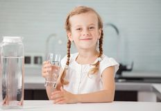 Child drinking water at home stock images