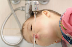 Child drinking water Royalty Free Stock Images
