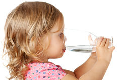 Child drinking water. Little child drinking water isolated over white stock photo