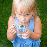 Child drinking water outdoors Stock Image
