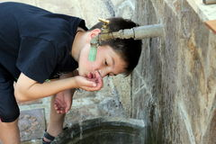 Child is drinking water Royalty Free Stock Image