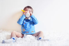A child drinking yogurt Royalty Free Stock Photos
