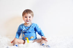 A child drinking yogurt Stock Photo