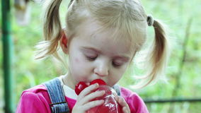 Child drinks from bottle stock video footage