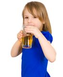 Child drinks juice Royalty Free Stock Photos