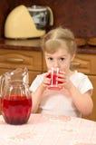 Child drinks juice Stock Photos