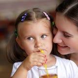 Child drinks juice royalty free stock photos