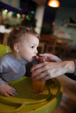 Child drinks juice Stock Image
