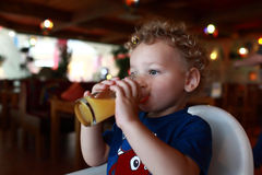 Child drinks juice Royalty Free Stock Photography