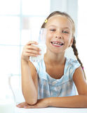 Child drinks milk Royalty Free Stock Image