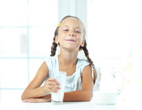 Child drinks milk Royalty Free Stock Photo