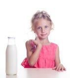 Child drinks milk Royalty Free Stock Photo