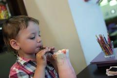 Child drinks milkshake Stock Images