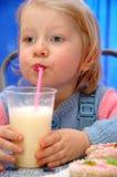 Child drinks milkshake from straw Royalty Free Stock Photography