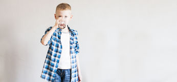 Child drinks pure water Royalty Free Stock Photo