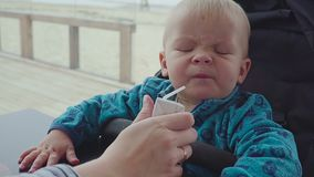A child drinks from a straw juice closeup stock video footage